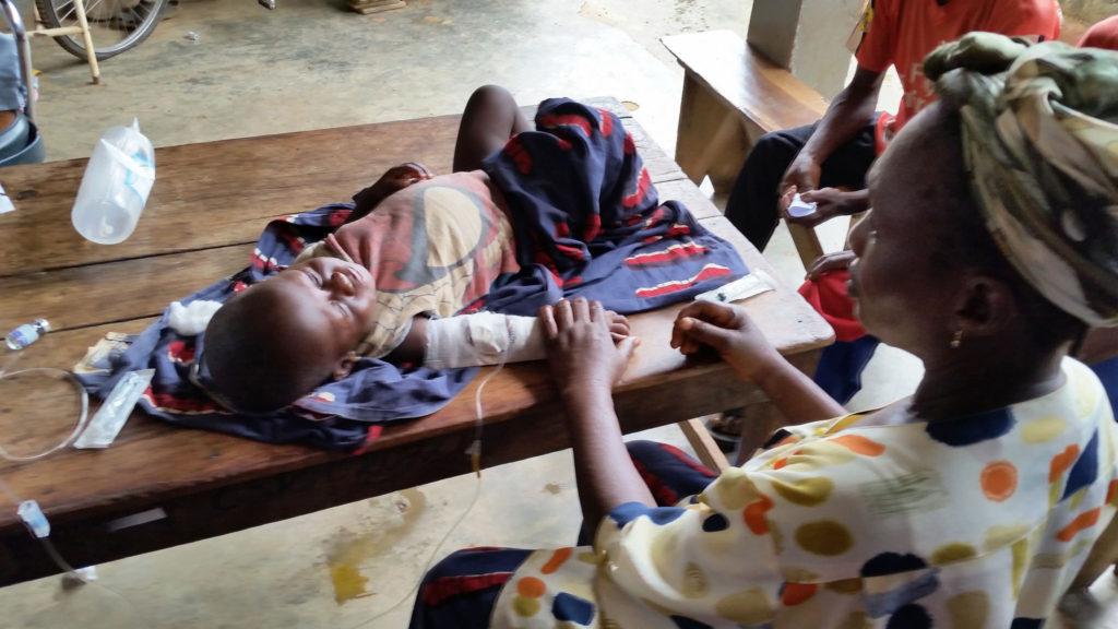 Kwilu Ngongo big existing CSCOM - mother and child has malaria - 30.1.2016